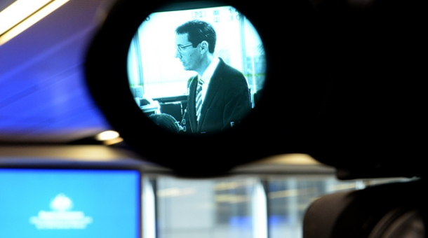 Counsel Assisting, Angus Stewart SC seen through the lens of a video camera during a public hearing