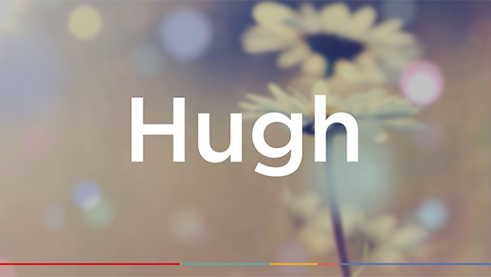 The text 'Hugh' with a blurred floral background