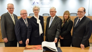 Commissioners with the Message to Australia book