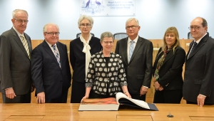 Commissioners and Dr Marie-Louise Ayers, the Director-General of the National Library with the Message to Australia book